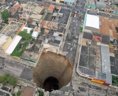 Depressed ground in Guatemala City: This sinkhole was estimated to be 60 feet wide and 300 feet deep