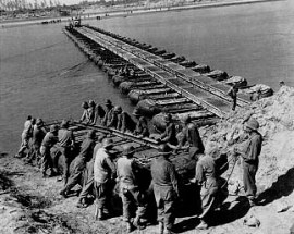 M-2 Treadway Pontoon Bridge under construction across the Po River near Ostiglia (National Archives)